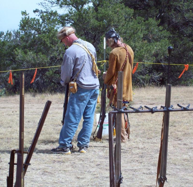 Father and Son Enjoy Shooting on the Fire Line