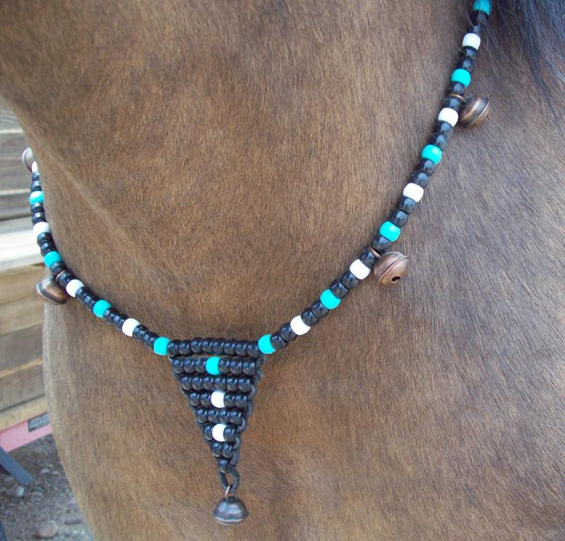 Lyle modeling turquoise, black, white beads with hawk bells, $18