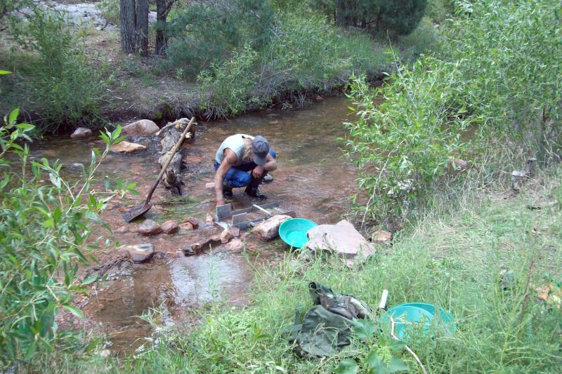 Using a sluice at a beautiful canyon creek approx elev 6400 ft